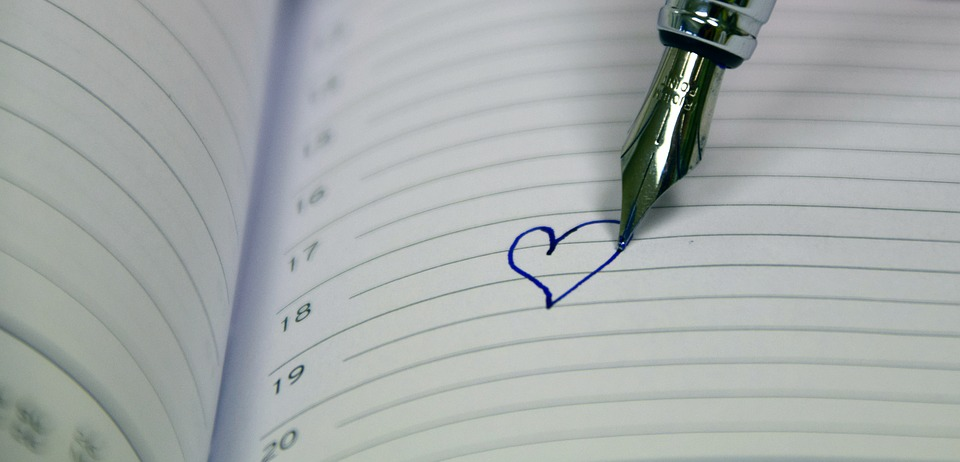 fountain pen writhing a heart in a diary