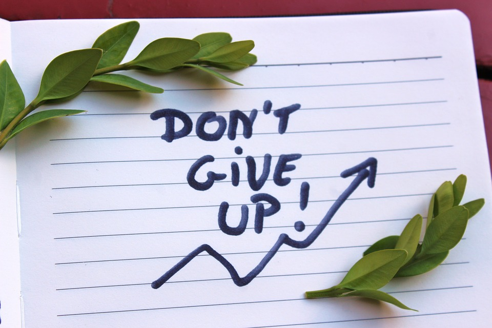 Don't Give Up written on lined paper