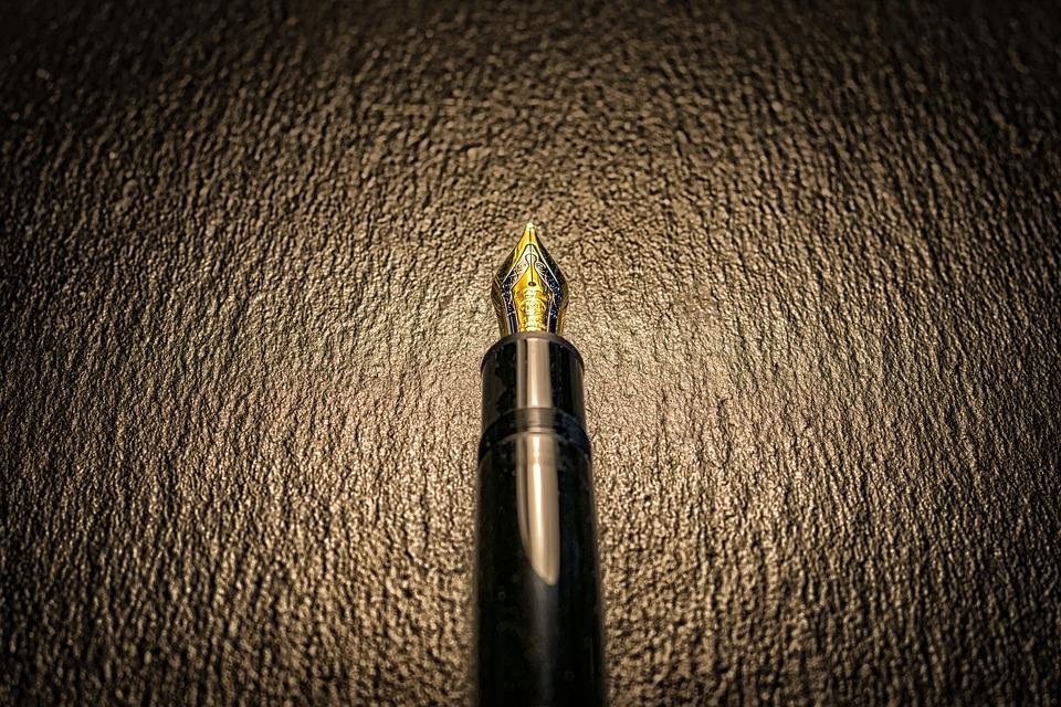 fountain pen over dark leather