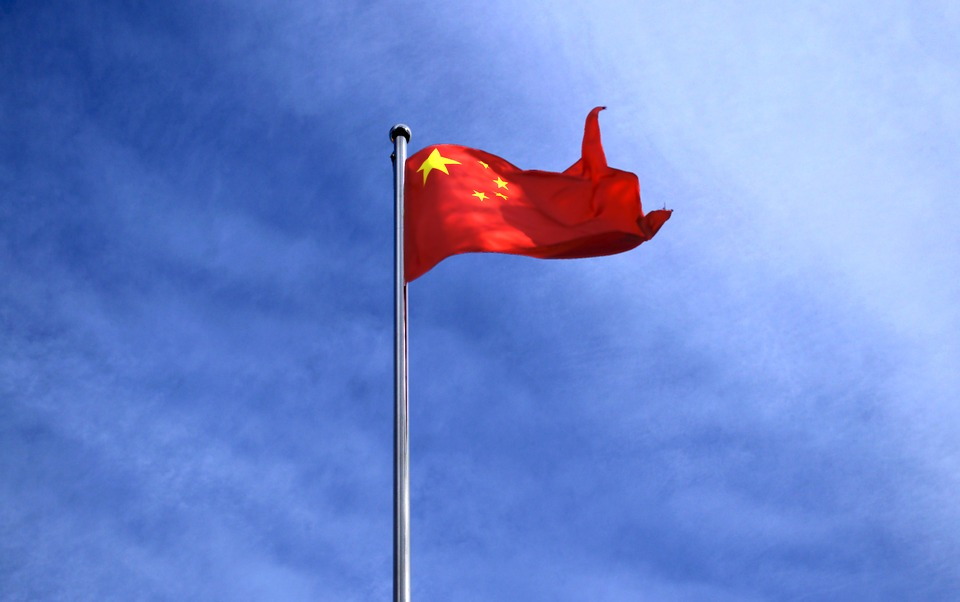 chinese flag flying against a blue sky