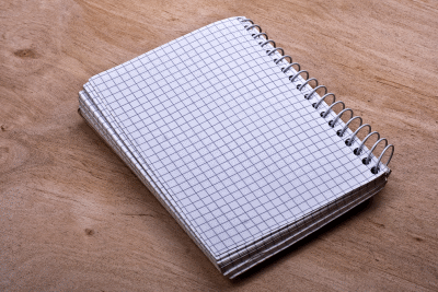 notepad on a wooden surface