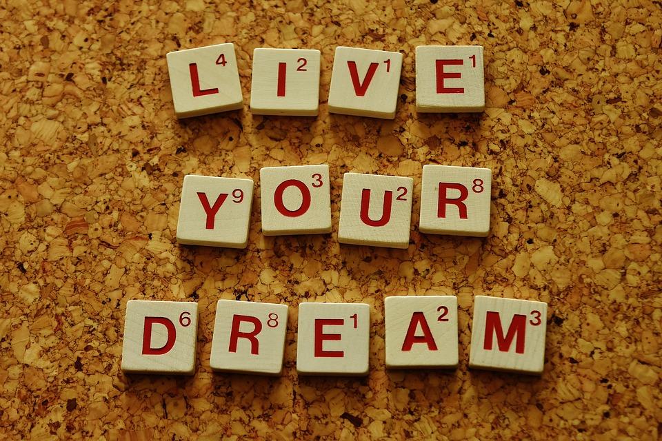 Live your dream in scrabble tiles over cork