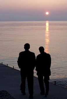 two people talking in sunset