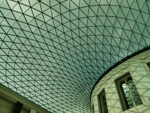 The ceiling of the great court, it is filled with glass geometric triangles