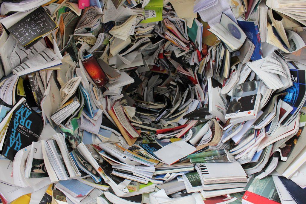 A whirlpool of books swirls.