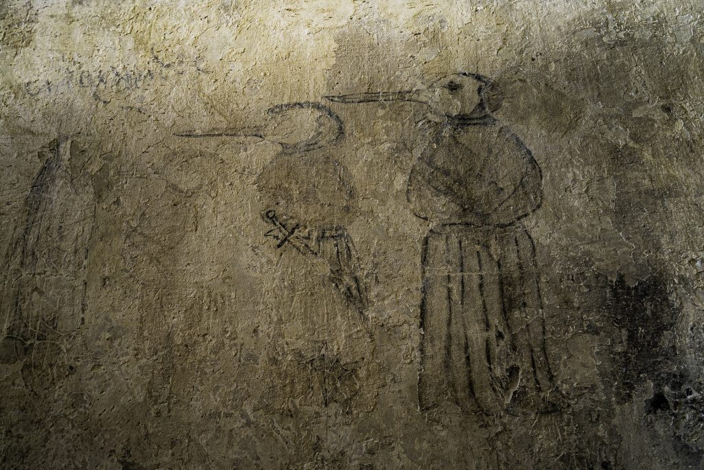 A wall drawing featuring a plague doctor, it's spooky