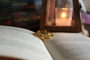 A small metal pendant is lying inside a book, it could be used to travel in time and get more stuff done